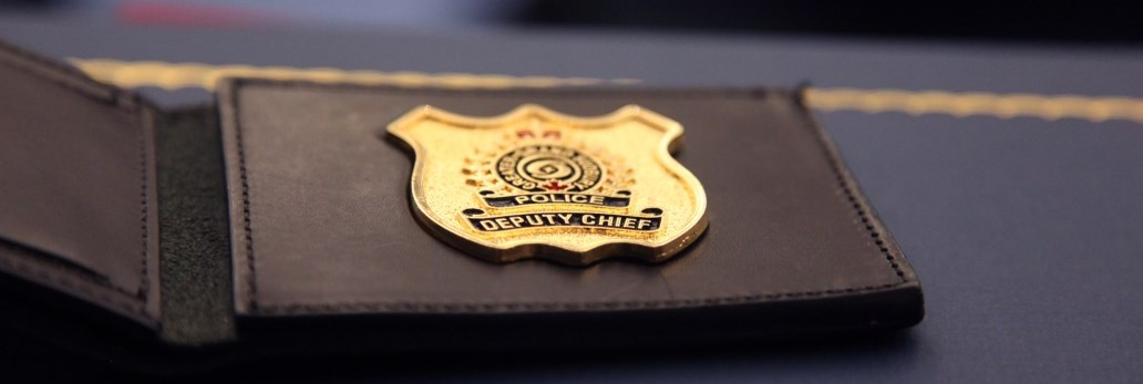 close up of Deputy Chief police badge on table