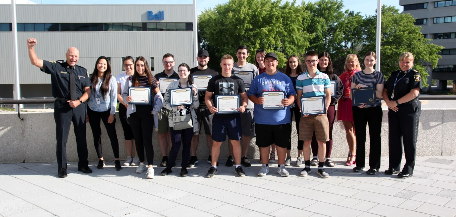 summer students standing with their completion certificates