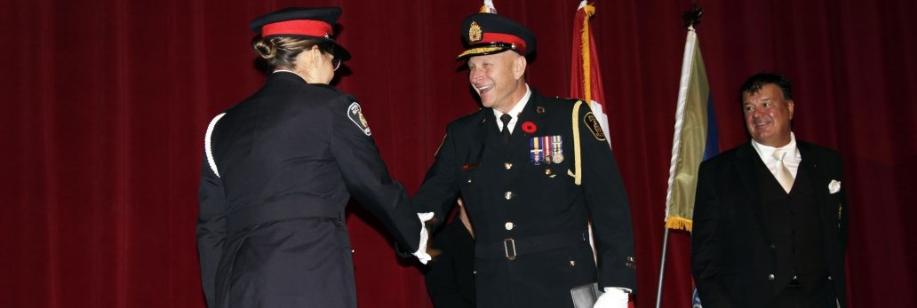 Chief smiling and shaking hand of new Officer recruit