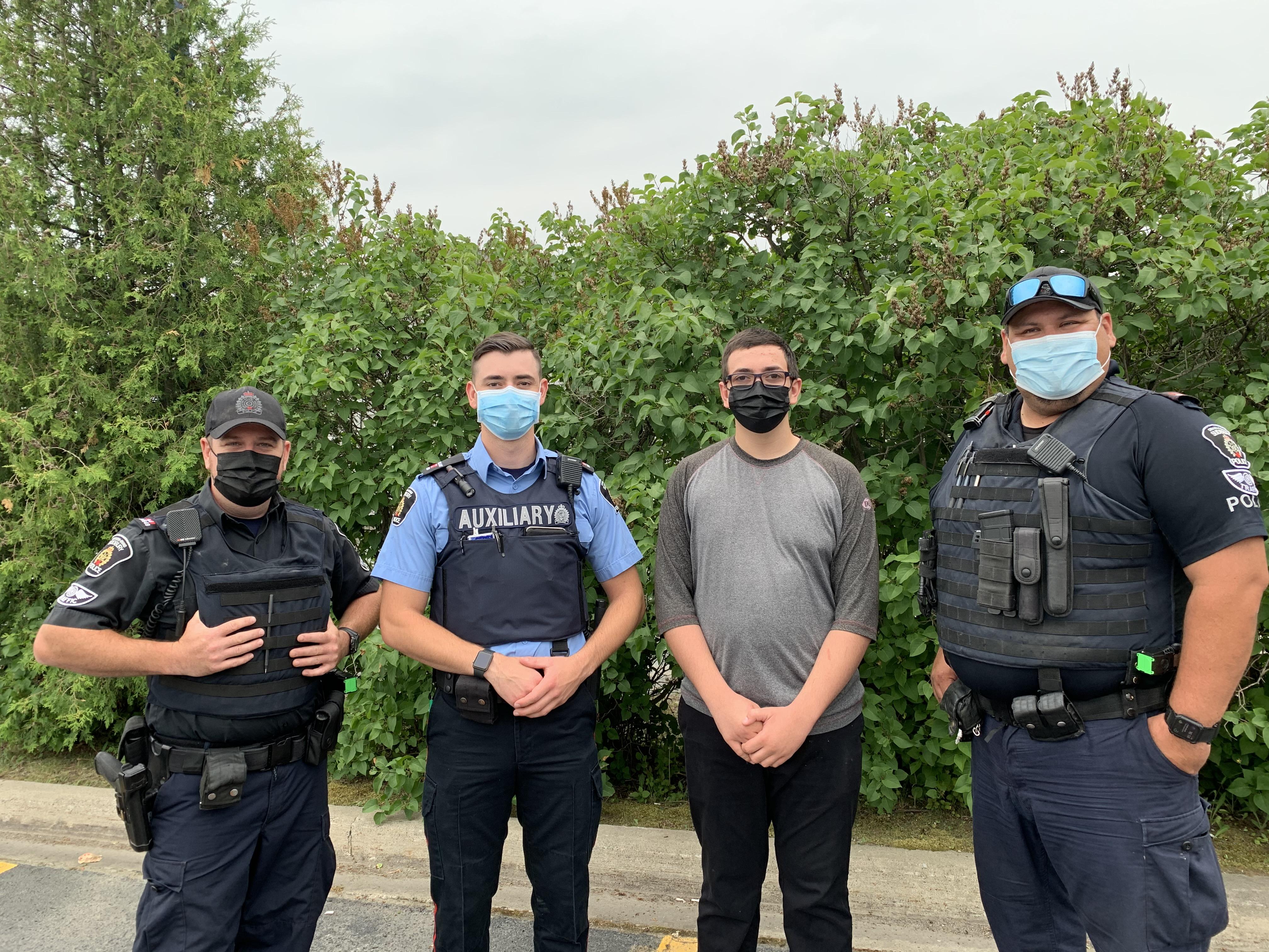 Four men standing wearing masks