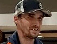Photo of suspect man wearing basball cap, brown hair, brown eye with missing front tooth