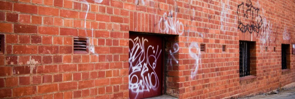 outer brick wall of building with graffiti